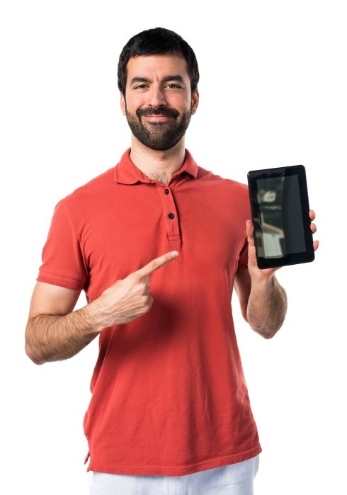 Handsome man holding a tablet